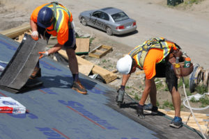 Shingling on a roof in Regina